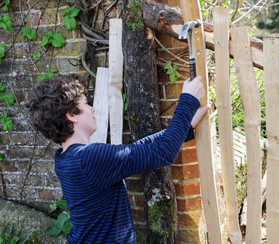 Boy making fence